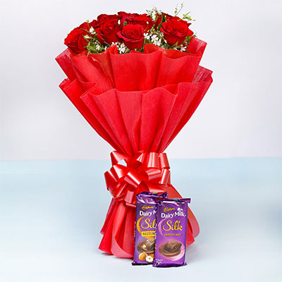 Red roses with chocolates