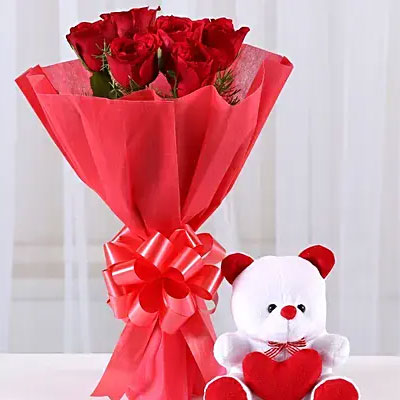 Red rose bouquet with teddy