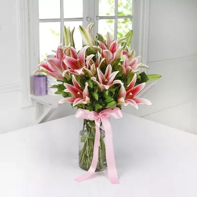 Vase of pink lilies