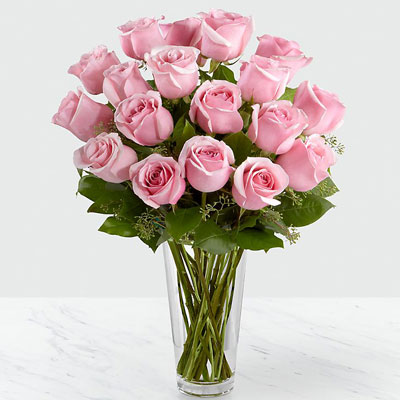 25 pink roses in vase