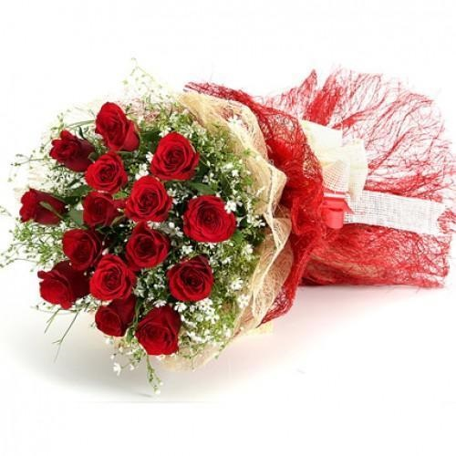 Perfect rosy red roses in red packing