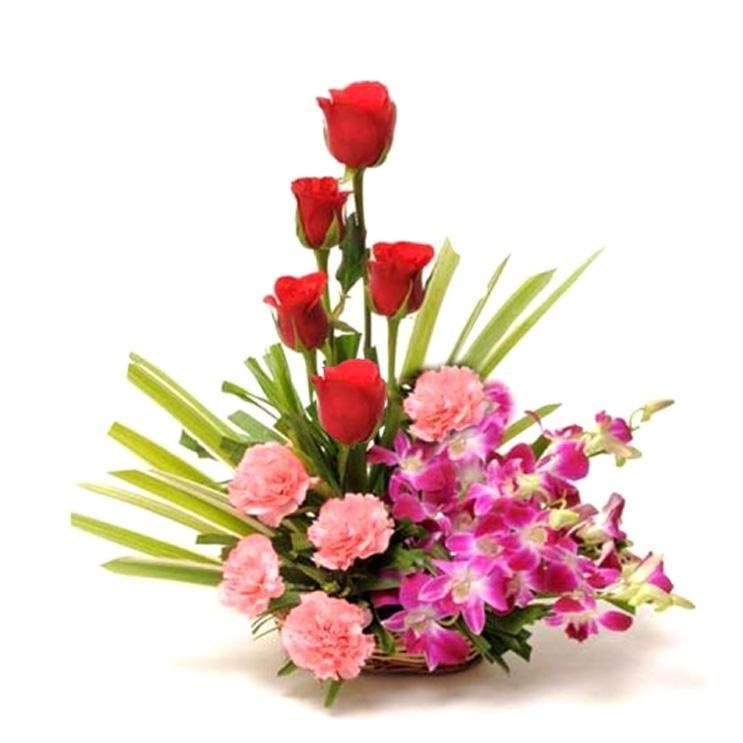Basket of orchids pink carnation and red roses
