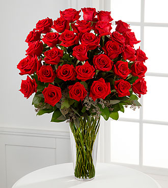 Long stem red rose arrangement in vase