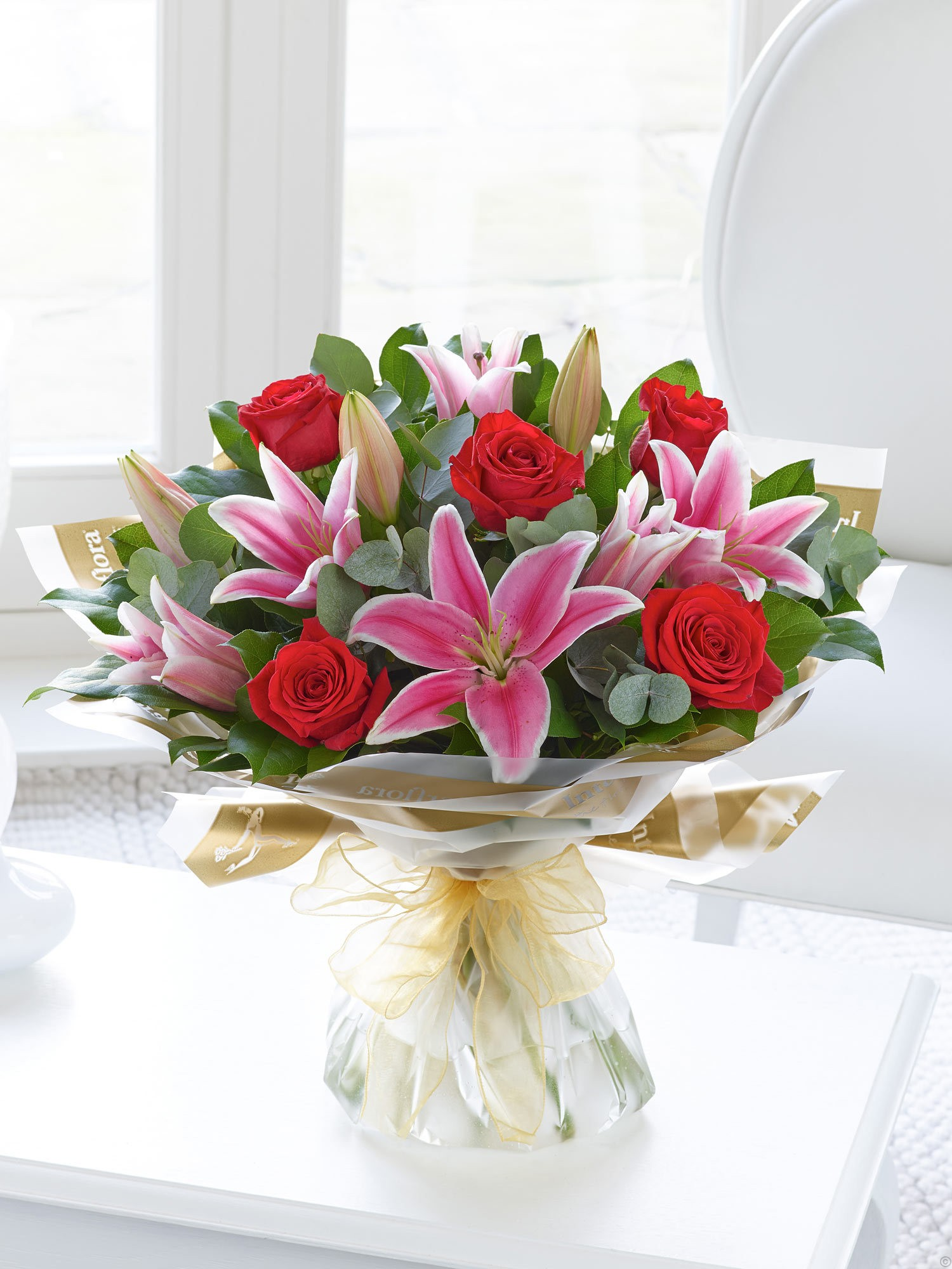 Red roses and pink lily